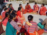 Picture of a womens group holding a meeting